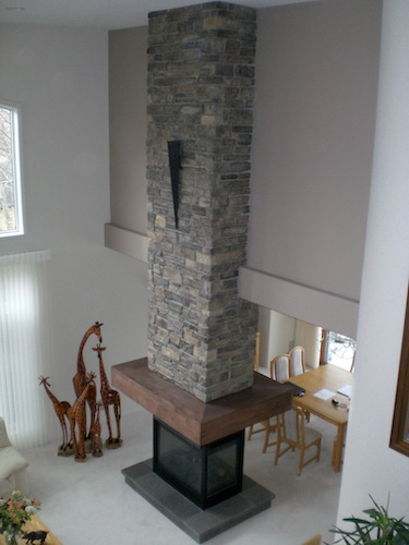 tall stacked stone fireplace surround
